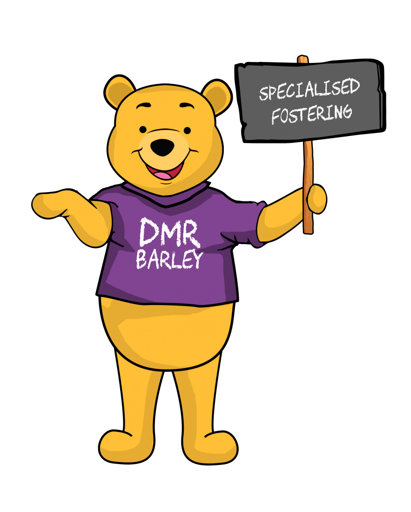 DMR Barley holding a sign talking about what is specialised fostering in Birmingham, Coventry and Wolverhampton West Midlands - DMR Fostering Services